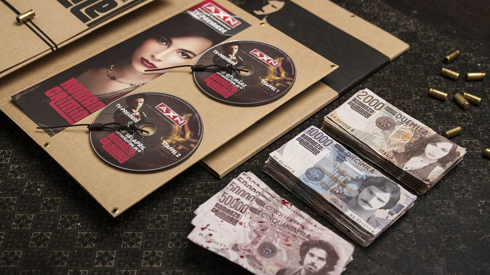 A X N, Romanzo Criminale press kit and counterfeit money, close side view