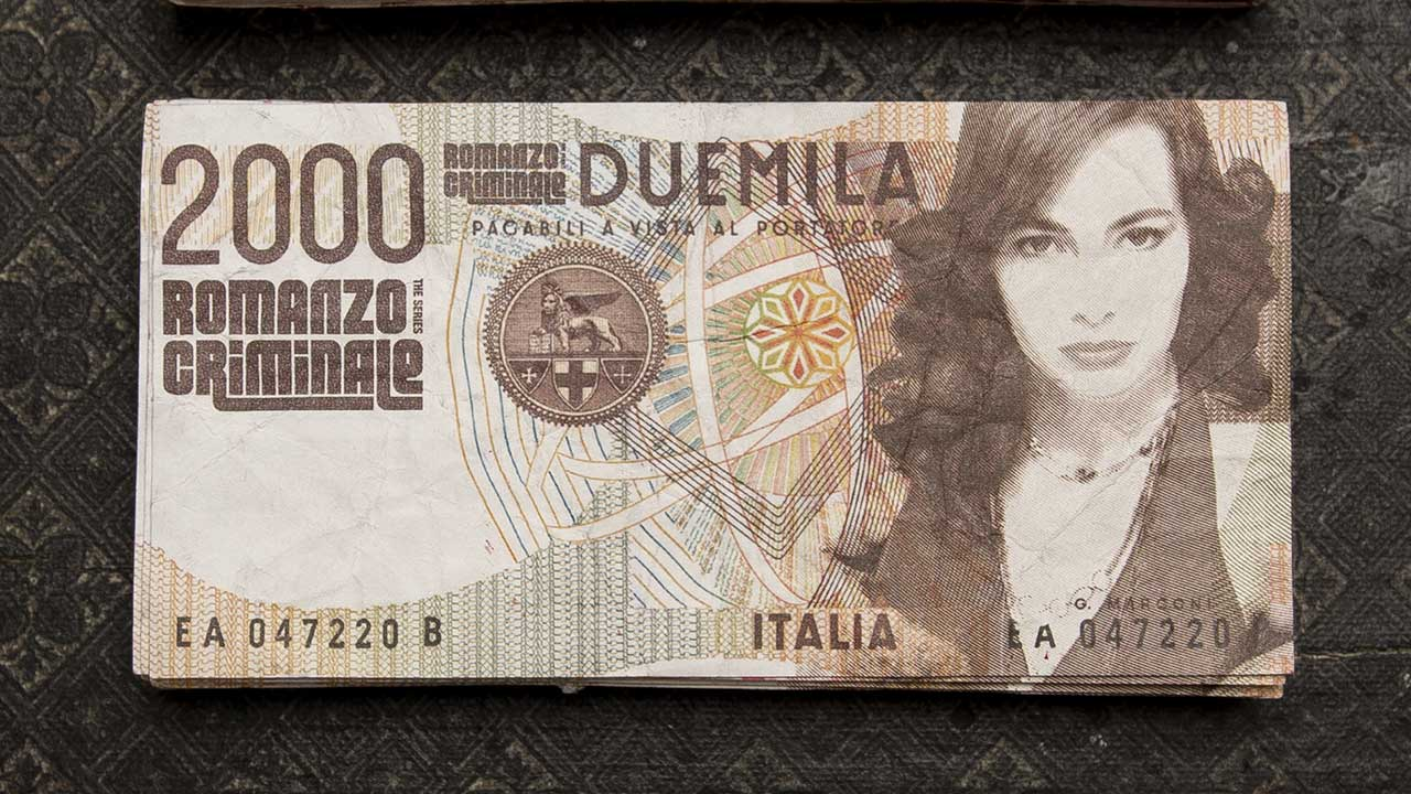 A X N, Romanzo Criminale promotion, portrait of an actress on the counterfeit money