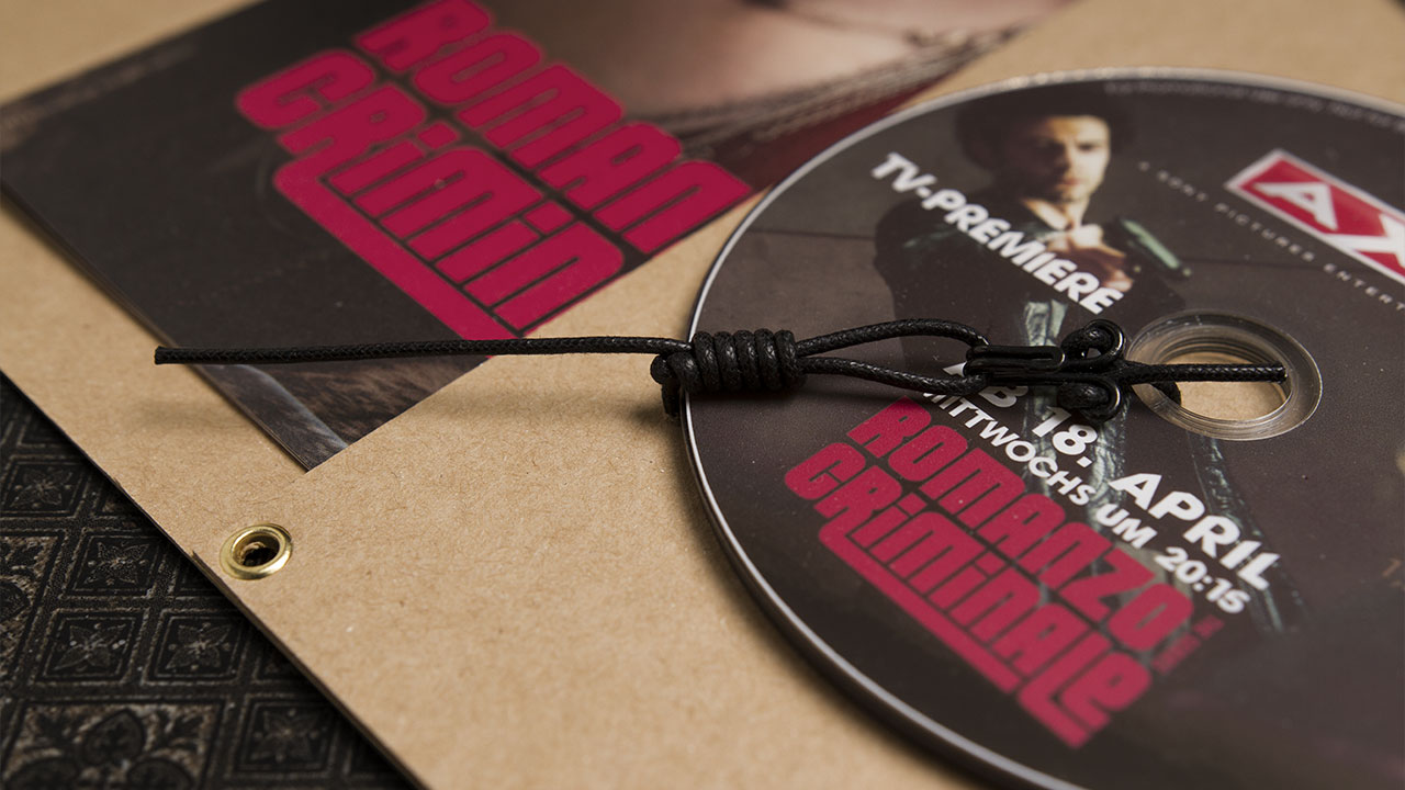 A X N, Romanzo Criminale press kit opened, detail of the DVD mount