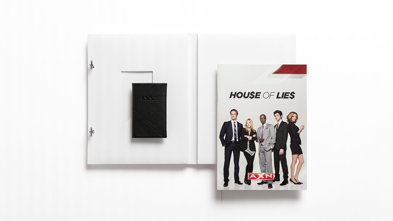 A X N, House of Lies press kit opened with brochure and business card case